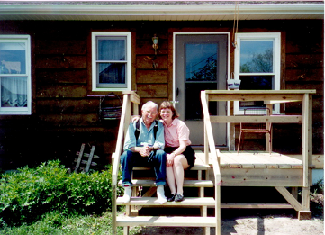 Roscoe and Laura on the back porch of the Churchill farm house (2001).