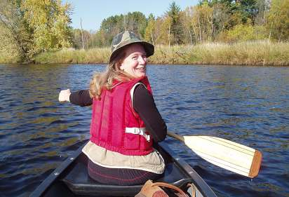 Laura Gauger paddling the Flambeau River (photo by Steve Garske of Marenisco, MI, Oct 2011)